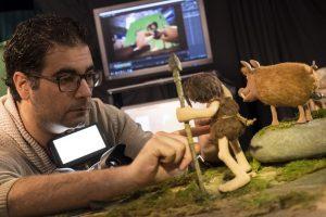 Junior Animator Emanuel Nevado posing Dug for a production still.